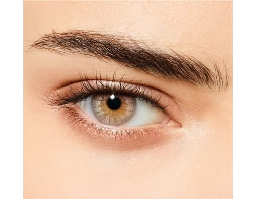 creamy beige colored contact lens